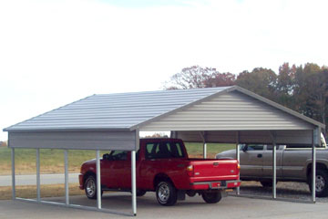 Carport with a quarter wall, wide gable, and a boxed eave.